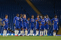 Chelsea players look on during Chelsea's 13-12 penalty shootout win as a record 34 spot-kicks are taken during the The Checkatrade Trophy match between Chelsea U23 and Oxford United at Stamford Bridge, London, England on 8 November 2016. Photo by Andy Rowland.