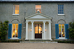 The regency country house Cavendish Hall, in Cavendish, Suffolk, United Kingdom. Cavendish Hall is a building belonging to the Landmark Trust, a United Kingdom building preservation charity that rescues historic buildings at risk and gives them a new life as places to stay in and experience.