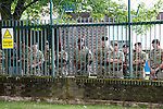 LONDON, ENGLAND, 22 May ,2014.  Soldiers watch from within Woolwich Barracks as bikers arrive to mark the first anniversary of the murder of Fusilier Lee Rigby  near his Woolwich barracks.