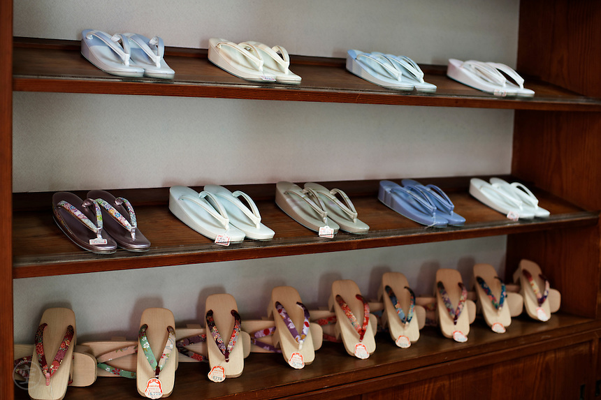 Traditional Japanese zori and geta shoes displayed in a Kyoto shop.
