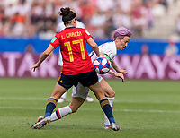 REIMS,  - JUNE 24: Lucia Garcia #17 defends Megan Rapinoe #15 during a game between NT v Spain and  at Stade Auguste Delaune on June 24, 2019 in Reims, France.
