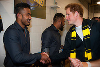 Prince Harry meets Rey Lee-Lo in the changing rooms after the Super Rugby match between the Hurricanes and Sharks at Westpac Stadium, Wellington, New Zealand on Saturday, 9 May 2015. Photo: Dave Lintott / lintottphoto.co.nz