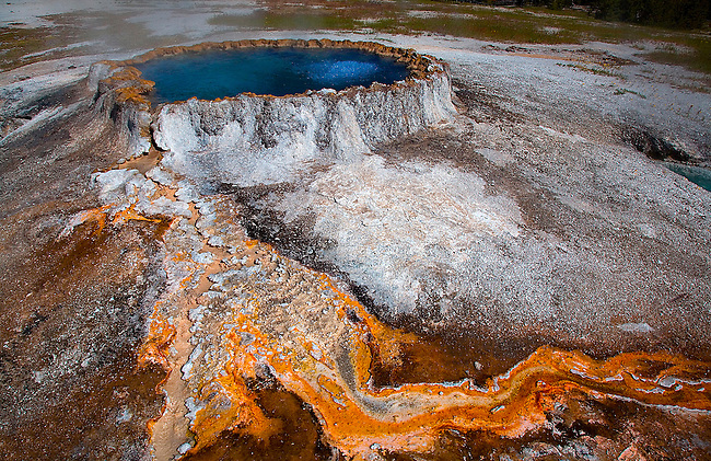 PUNCH BOWL SPRING PRODUCES VIVID COLORS FROM BACTERIA AND MICRORGANISMS THAT THRIVE IN THE HOT WATERS IN THE UPPER GEYSER BASIN AT OLD FAITHFUL IN YELLOWSTONE NATIONAL PARK, WYOMING
