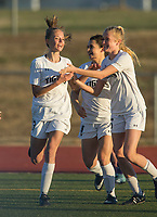 NWA Democrat-Gazette/BEN GOFF @NWABENGOFF<br /> Ginger Olson (from left), Tyler Ann Reash and Sydney Suggs of Bentonville celebrate a goal by Olson against Fayetteville Tuesday, March 13, 2018, during the match at Bentonville's Tiger Athletic Complex.