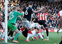8th February 2020; Griffin Park, London, England; English Championship Football, Brentford FC versus Middlesbrough; Julian Jeanvier of Brentford shoots to score his sides 1st goal in the 24th minute to make it 1-0 - Strictly Editorial Use Only. No use with unauthorized audio, video, data, fixture lists, club/league logos or 'live' services. Online in-match use limited to 120 images, no video emulation. No use in betting, games or single club/league/player publications