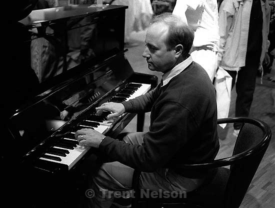 Steve Nelson pretends to play the piano at Nordstrom's.<br />