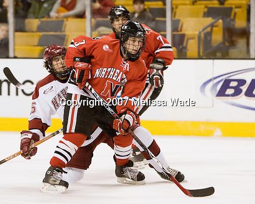 Ryan Ginand (NU - 3), Doug Rogers (Harvard - 15) - The Northeastern University Huskies defeated the Harvard University Crimson 3-1 in the Beanpot consolation game on Monday, February 12, 2007, at TD Banknorth Garden in Boston, Massachusetts.