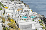 Luxury villas on the edge of the caldera in Oia on the island of Santorini in Greece.