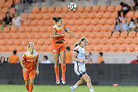Houston, TX - Saturday July 08, 2017: Carli Lloyd heads the ball over Lindsey Horan during a regular season National Women's Soccer League (NWSL) match between the Houston Dash and the Portland Thorns FC at BBVA Compass Stadium.