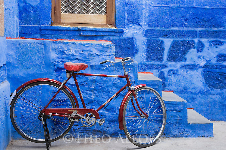 Bicycle in front of blue house in Blue City (old town); the blue houses were originally for Brahmins but non-Brahmins soon joined in, as the colour was said to deflect the heat and keep mosquitoes away, Jodphur, Rajasthan, India --- Model Released