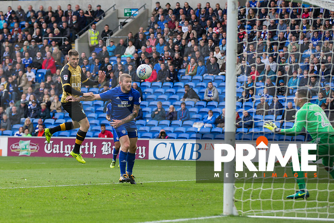 Gary Hooper of Sheffield Wednesday outjumps Aron Gunnarsson of Cardiff City to score his side's opening goal during the Sky Bet Championship match between Cardiff City and Sheffield Wednesday at Cardiff City Stadium, Cardiff, Wales on 16 September 2017. Photo by Mark  Hawkins / PRiME Media Images.