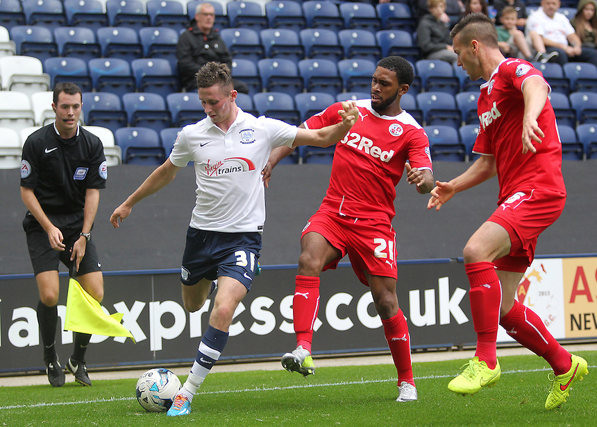 Preston North End's Alan Browne under pressure from Crawley Town's Gavin Tomlin<br /> <br /> Photographer Rich Linley/CameraSport<br /> <br /> Football - The Football League Sky Bet League One - Preston North End v Crawley Town - Saturday 20th September 2014 - Deepdale - Preston<br /> <br /> &copy; CameraSport - 43 Linden Ave. Countesthorpe. Leicester. England. LE8 5PG - Tel: +44 (0) 116 277 4147 - admin@camerasport.com - www.camerasport.com