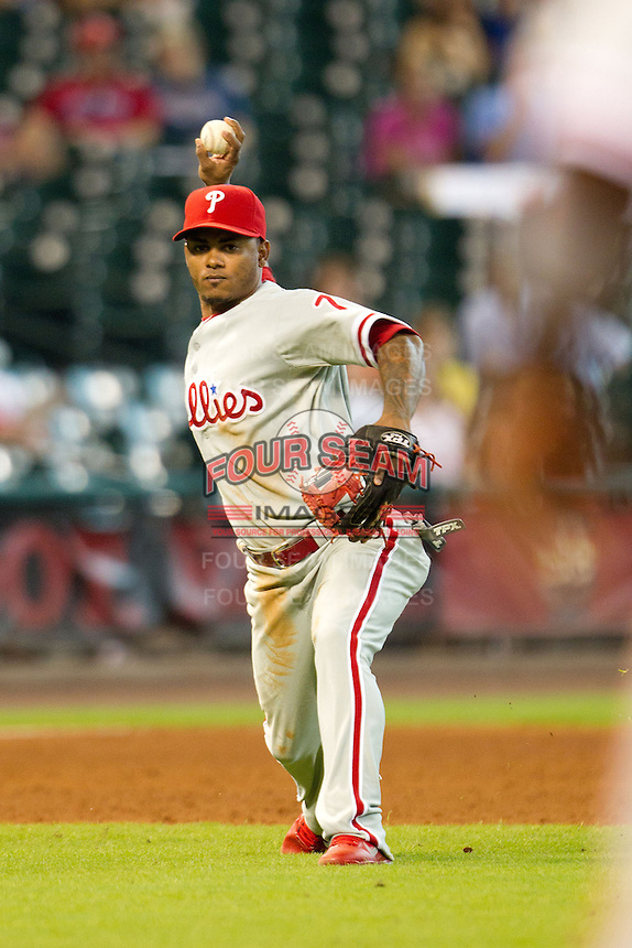 Philadelphia Phillies third baseman Michael Martinez #7 throws to first during the Major League baseball game against the Houston Astros on September 16th, 2012 at Minute Maid Park in Houston, Texas. The Astros defeated the Phillies 7-6. (Andrew Woolley/Four Seam Images).