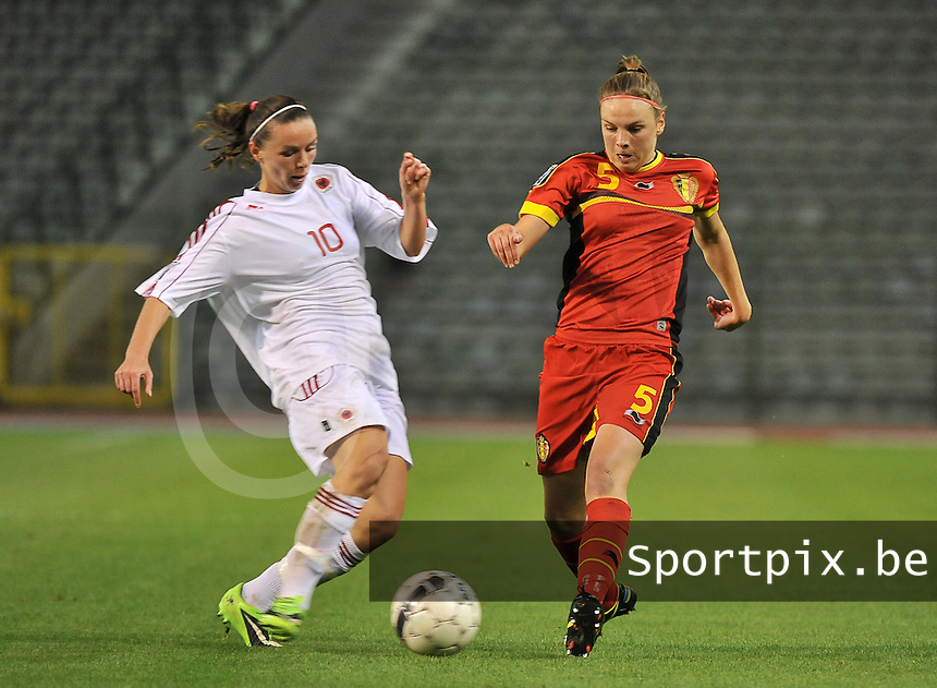 20130921 - BRUSSELS , BELGIUM : duel pictured between Belgian Lorca Van De Putte (right) and Albanian Velaj Furtuna (10) during the female soccer match between Belgium and Albania , on the first matchday in group 5 of the UEFA qualifying round to the FIFA Women World Cup in Canada 2015 at the Koning Boudewijn Stadion , Brussels . Saturday 21th September 2013. PHOTO DAVID CATRY