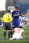 23 April 2009:  Jimmy Conrad (right) of the Wizards pleads his case with Referee Michael Kennedy after receiving a yellow card caution for fouling Jorge Rojas (13) of the Red Bulls.  The MLS Kansas City Wizards defeated the visiting New York Red Bulls 1-0 at Community America Ballpark in Kansas City, Kansas.