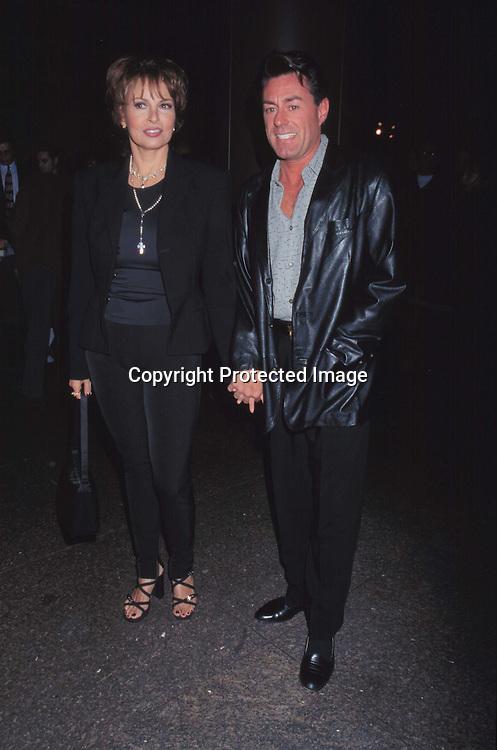 "©KATHY HUTCHINS/HUCTHINS.1/26/98 "" GIA "" PREMIERE.RAQUEL WELCH & MICHAEL PALMER"