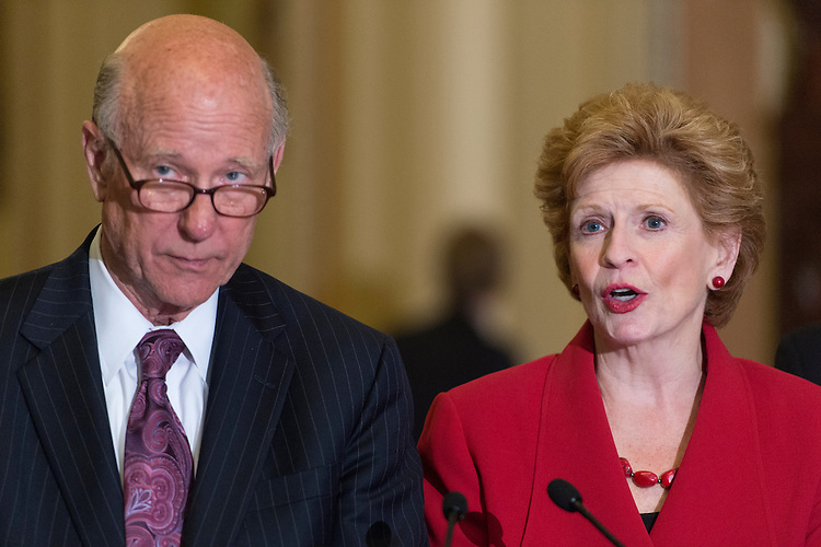 "UNITED STATES - JUNE 21: Senate Agriculture ranking member Pat Roberts, R-Kan., and Senate Agriculture Chairwoman Debbie Stabenow, D-Mich., hold a media availability immediately following the Senate's final vote today on the ""Agriculture Reform, Food and Jobs Act"" (Farm Bill) in the Capitol on Thursday, June 21, 2012. (Photo By Bill Clark/CQ Roll Call)"