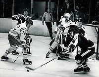 Seals Butch Williams #12, Toronto's  Rod Seiling,#4 is Dave Dunn, and #17 Blaine Stoughten. (photo by Ron Riesterer)