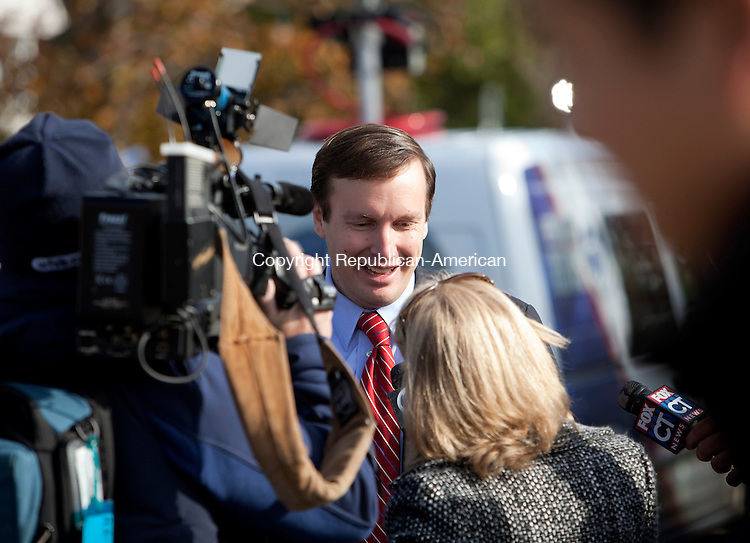 CHESHIRE, CT-6 November 2012-110612BF06-- Democratic Congressman Chris Murphy, who represents the 5th Congressional District, is surrounded by media prior to entering Cheshire High School to vote Tuesday. Murphy is in a tight race against Republican challenger Linda McMahon for a seat in the U.S. Senate..Bob Falcetti Republican-American