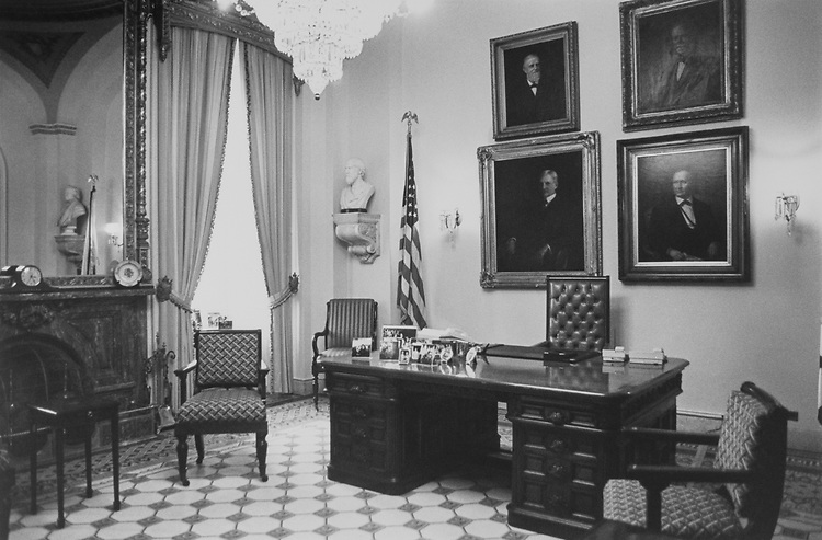 "Vice President Dan Quayle's ""Ceremonial Office"" in the Capitol. Portraits include Former Indiana Vice President Candidates. Pictures of Dan Quayle and his family are on the desk. 1989 (Photo by Laura Patterson/CQ Roll Call via Getty Images)"