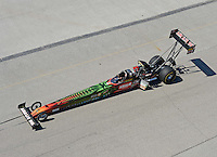 Sept. 29, 2012; Madison, IL, USA: NHRA top fuel dragster driver Terry McMillen being towed back to the pits during qualifying for the Midwest Nationals at Gateway Motorsports Park. Mandatory Credit: Mark J. Rebilas-
