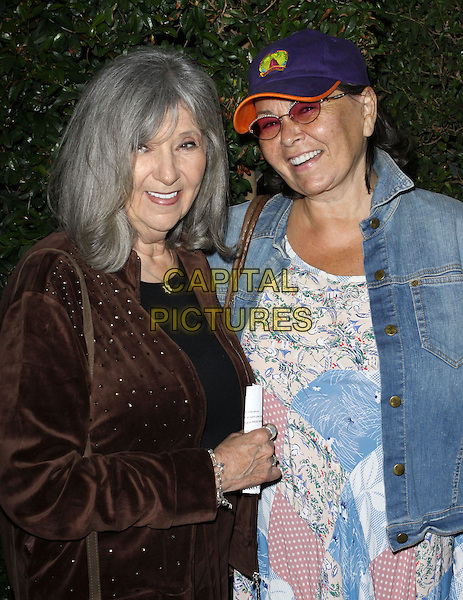 "HELEN & ROSEANNE BARR.""Capitalism: A Love Story"" Los Angeles Premiere held At AMPAS Samuel Goldwyn Theater, Beverly Hills, California, USA..September 15th, 2009.half length jean jacket white blue pink pattern dress baseball cap hat mother mom mum daughter family  brown velvet jacket.CAP/ADM/KB.©Kevan Brooks/AdMedia/Capital Pictures."