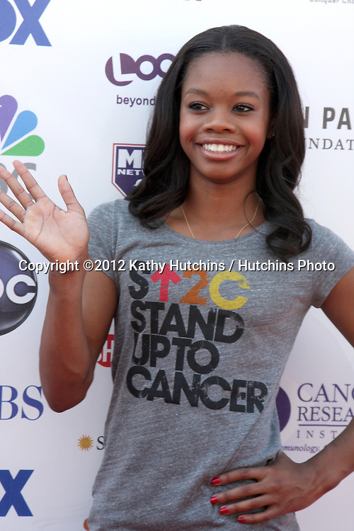 LOS ANGELES - SEP 7:  Gabby Douglas arrives at the 2012 Stand Up To Cancer Benefit at Shrine on September 7, 2012 in Los Angeles, CA
