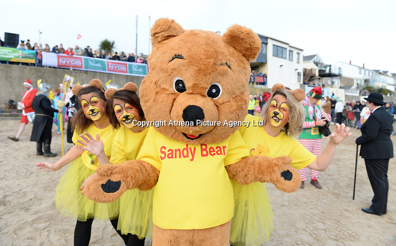 Hundreds take part in this year's Saundersfoot New Year Swim the theme of which was Tour De France winner Geraint Thomas in Pembrokeshire, Wales, UK. Tuesday 01 January 2019
