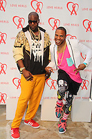 Emmanuel Whitmore and Kareem Youngblood attend The Let's Misbehave Party to Benefit Love Heals on July 19, 2014 (Photo By Taylor Donohue/Guest Of A Guest)