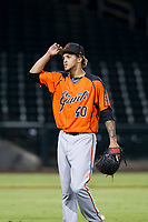 AZL Giants relief pitcher Miguel Figueroa (40) walks off the field between innings of the game against the AZL Cubs on September 6, 2017 at Sloan Park in Mesa, Arizona. AZL Giants defeated the AZL Cubs 6-5 to even up the Arizona League Championship Series at one game a piece. (Zachary Lucy/Four Seam Images)