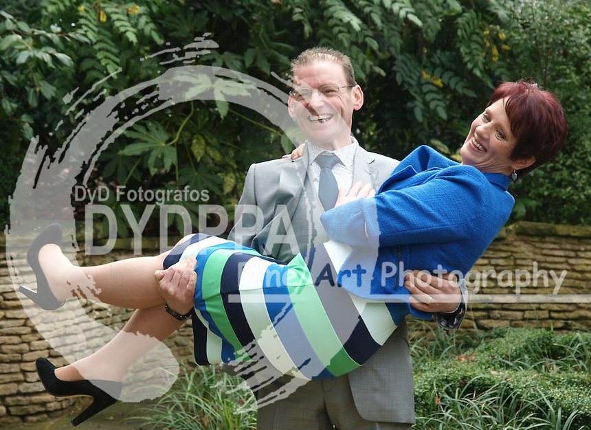 James Quinn, 45, and his wife Joyce after they had lost 15 st 12 and half ,101kls, and while she lost 4st 5pound, 28 kls, after they were named Slimming World Couple of year, UK, Friday March 15, 2013. Photo by Max Nash / i-Images/DYD Fotografos