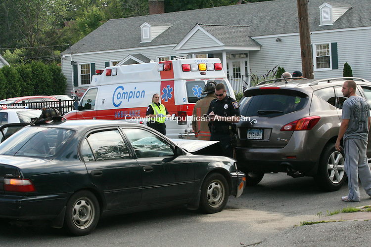 TORRINGTON, CT - 9 July, 2009 - 070909MO05 - A witness who saw the crash said the Toyota Corolla seen here, driven by a woman with child passengers, rear-ended the Nissan Murano SUV driven by a pregnant woman on Albert Street just west of Wilson Avenue shortly after 4 p.m. Thursday. Police said no serious injuries resulted, though the driver who was found to be at fault was transported to Charlotte Hungerford Hospital for treatment of chest pain. Police had no details available Thursday night on the identities of those involved. One of the vehicles was towed from the scene. Jim Moore Republican-American.