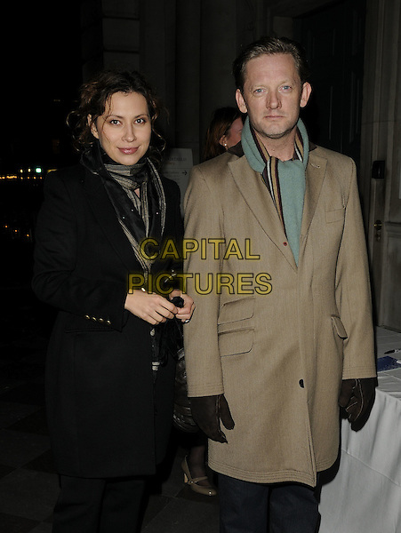 GUESTS.Tiffany & Co. presents Skate at Somerset House, VIP Opening of the 10th Annual Somerset House Ice Rink, London, England. .November 16th, 2009 .half 3/4 length beige black coat scarf .CAP/CAN.©Can Nguyen/Capital Pictures.