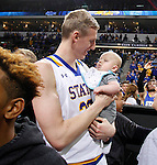 SIOUX FALLS, SD - MARCH 8:  Connor Devine from South Dakota State celebrates with his baby after the Jackrabbits defeated the North Dakota State Bison in the 2016 Summit League Championship Tuesday night in Sioux Falls, S.D. (Photo by Dave Eggen/Inertia)