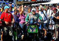 Sept. 18, 2010; Concord, NC, USA; NHRA funny car driver John Force rides his scooter through a crowd of fans during qualifying for the O'Reilly Auto Parts NHRA Nationals at zMax Dragway. Mandatory Credit: Mark J. Rebilas /