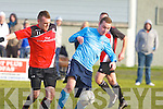 Park's Mark O'Sullivan and Kilbarrack United's Aaron Humphries go for the ball in the FAI Junior cup in Dublin on Sunday
