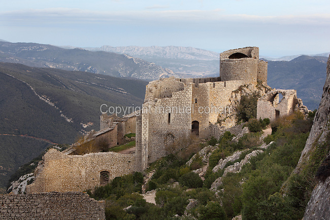 """View of Lower Castle, Peyrepertuse Castle or Chateau Pierre Pertuse, Cathar Castle, Duilhac-sous-Peyrepertuse, Corbieres, Aude, France. This castle consists of a Lower Castle built by the Kings of Aragon in the 11th century and a High Castle built by Louis IX in the 13th century, joined by a huge staircase. Its name means pierced rock in Occitan and it has been associated with the Counts of Narbonne and Barcelona. It is one of the """"Five Sons of Carcassonne"""" or """"cinq fils de Carcassonne"""" and is a listed monument historique. Picture by Manuel Cohen"""