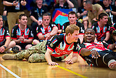 Prince Harry of Wales reacts to a scoring play during an exhibition volleyball match between U.S. and U.K. wounded warrior volleyball teams during the Warrior Games here May 11, 2013. Olympic gold medalists Misty May-Treanor, Missy Franklin and Paralympic medalists Kari Miller and Brad Snyder were in attendance to support the wounded athletes. From May 11-16, more than 200 wounded, ill and injured service members and veterans from the U.S. Marines, Army, Air Force and Navy, as well as a team representing U.S. Special Operations Command and an international team representing the United Kingdom, will compete for the gold in track and field, shooting, swimming, cycling, archery, wheelchair basketball and sitting volleyball at the U.S. Olympic Training Center and U.S. Air Force Academy here. The military service with the most medals will win the Chairman's Cup..Mandatory Credit: Tyler L. Main / DoD via CNP
