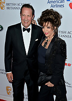BEVERLY HILLS, CA. October 26, 2018: Joan Collins & Percy Gibson at the 2018 British Academy Britannia Awards at the Beverly Hilton Hotel.<br /> Picture: Paul Smith/Featureflash
