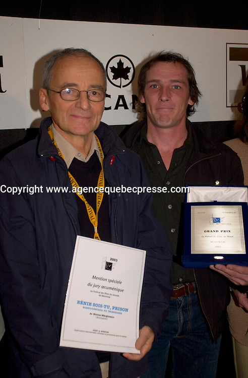 Sept 7,  2003, Montreal, Quebec, Canada<br /> <br />  Montreal director Louis Blanger  (R)r receive the OECUMNICAL AWARD for his movie, based on hos father's life and values, while Nicolae Margineami (L) received a mention for his movie<br /> <br /> <br /> <br /> The Festival runs from August 27th to september 7th, 2003<br /> <br /> <br /> Mandatory Credit: Photo by Pierre Roussel- Images Distribution. (&copy;) Copyright 2003 by Pierre Roussel <br /> <br /> All Photos are on www.photoreflect.com, filed by date and events. For private and media sales