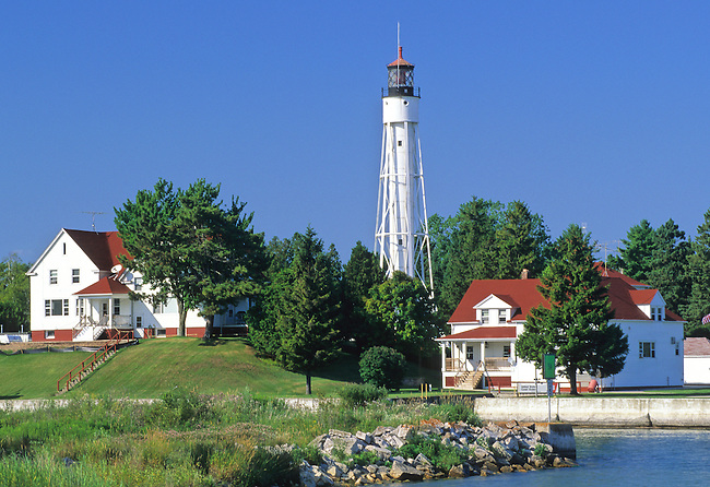 The Sturgeon Bay Canal Light & Coast Guard Station guards the southern entrance to the Sturgeon Bay Canal, a man made channel that cut hours off the long and sometimes dangerous trip around the Door Peninsula and through the Death's Door Passage into the calmer waters of Green Bay.
