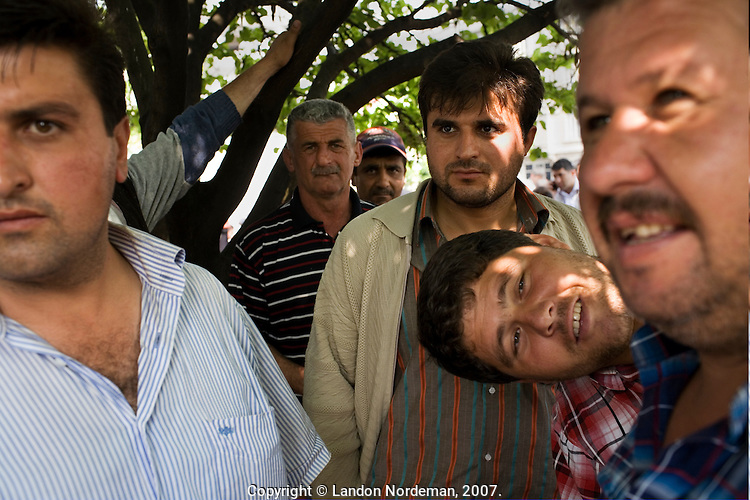 ISTANBUL - MAY 25, 2007:   A group of Turkish men in Istanbul, Turkey. Photo by Landon Nordeman.