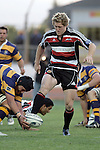 James Maher kicks the loose ball ahead as Aaron Rameka attempts to grab it during the Air NZ Cup rugby game between Bay of Plenty & Counties Manukau played at Blue Chip Stadium, Mt Maunganui on 16th of September, 2006. Bay of Plenty won 38 - 11.