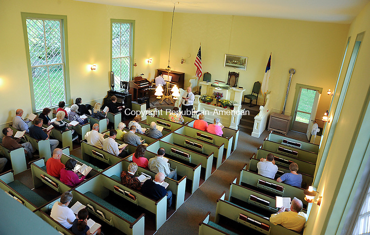 COLEBROOK, CT 28 SEPTEMBER 2013--092913JS08- Parishioners sing hymns during Vesper Services as part of the Fall Foliage Service at the historic Church in the Wildwood in Colebrook on Sunday. <br /> Jim Shannon Republican American