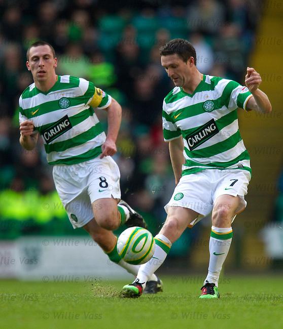 Scott Brown watches Robbie Keane