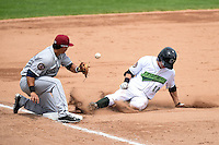 Jamestown Jammers outfielder Carl Anderson (18) slides into third as third baseman Yonathan Mendoza (10) fields a throw during a game against the Mahoning Valley Scrappers on June 16, 2014 at Russell Diethrick Park in Jamestown, New York.  Mahoning Valley defeated Jamestown 2-1.  (Mike Janes/Four Seam Images)