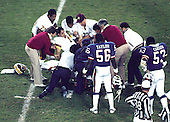 New York Giants linebackers Lawrence Taylor (56) and Harry Carson (53) look on as Washington Redskins quarterback Joe Theismann (7) is carried off the field on a stretcher after suffering a career-ending injury at RFK Stadium in Washington, D.C. on Monday, November 18, 1985. The Redskins won the game 23 - 21..Credit: Arnie Sachs / CNP