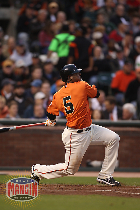 SAN FRANCISCO - JUNE 25:  Juan Uribe #5 of the San Francisco Giants hits a home run against the Boston Red Sox during the game at AT&T Park on June 25, 2010 in San Francisco, California. Photo by Brad Mangin