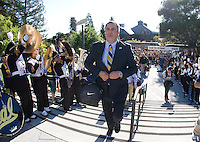 California head coach Sonny Dykes walk up on the stairs to the stadium before the game against Northwestern at Memorial Stadium in Berkeley, California on August 31st, 2013.  Northwestern defeated CAL, 44-30.