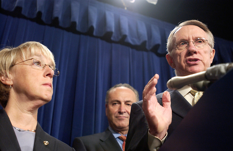 "WASHINGTON - July 12:  Sen. Patty Murray, D-Wash., Sen. Charles E. Schumer, D-N.Y., and Majority Leader Harry Reid, D-Nev., at a news conference.  Reid said the interim White House progress report on Iraq merely underscores the need for Congress to intervene with a firm target for action. ""The report confirmed what many had suspected: the war in Iraq is heading in a dangerous direction. It's well past time for a change of course in Iraq,"" he said. Reid, Durbin, Murray, and Schumer said they would send a letter to the president Thursday afternoon asking for information about the reported buildup of Al Qaeda in Iraq and elsewhere and what the United States is doing to combat it. Durbin made clear that the Democratic strategy is to present next week's vote on the Levin-Reed withdrawal amendment as the one key vote on Iraq policy. ""There will be one clear, unequivocal vote,"" Durbin said. ""This will be a moment for those Republican senators who question the policy of this administration to show that they really want change."" Reid and other Democratic leaders continued to dismiss as toothless a bipartisan alternative proposed by Ken Salazar, D-Colo., that would embrace the recommendations of the Iraq Study Group without setting a firm deadline for withdrawal. (Photo by Dana Statton/Congressional Quarterly)."